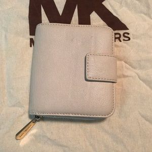 Michael Kors Bags - Michael Kors zip around wallet